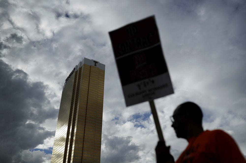 In this Sept. 21, 2016 file photo Laborers' International Union of North America members and Culinary Union members protest outside of the Trump International hotel in Las Vegas. (John Locher/ AP)
