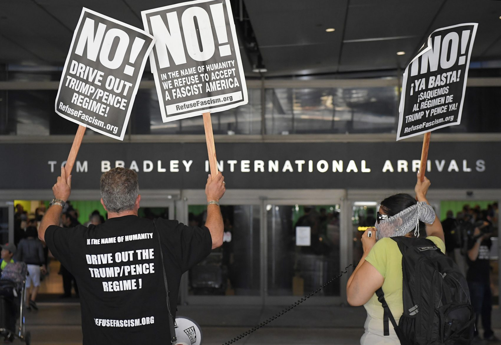 Activists protest outside the Tom Bradley International Terminal at Los Angeles International Airport, Thursday, June 29, 2017, in Los Angeles. (Mark J. Terrill/ AP)