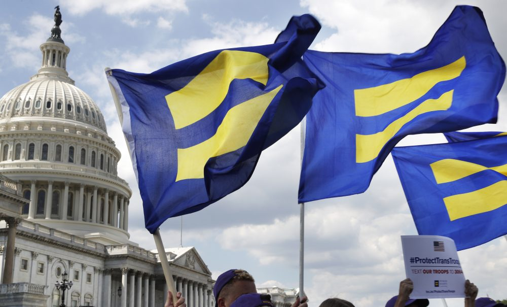 """People with the Human Rights Campaign hold up """"equality flags"""" during an event organized by Rep. Joe Kennedy, D-Mass., in support of transgender members of the military, Wednesday, July 26, 2017, on Capitol Hill in Washington, after President Donald Trump said he wants transgender people barred from serving in the U.S. military """"in any capacity,"""" citing """"tremendous medical costs and disruption."""" (Jacquelyn Martin/ AP)"""