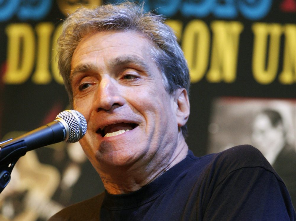 """In this May 6, 2010 file photo, former U.S. poet laureate Robert Pinsky recites one of his poems on stage at Fairleigh Dickinson University in Madison, N.J. Dozens of prominent poets will be at the Boston Public Library on Thursday evening, July 27, 2017, to read aloud from the city's first anthology of poetry ,""""City of Notions."""" Pinsky, who teaches English and creative writing at Boston University, is among nearly 60 contributors to the anthology.  (AP Photo/Mel Evans, File)"""