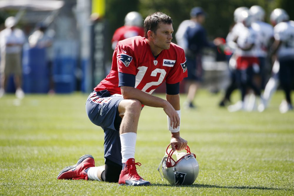 New England Patriots quarterback Tom Brady on the field during NFL football training camp. (Michael Dwyer/AP)
