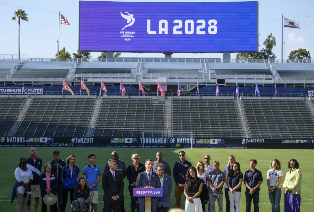 Los Angeles Mayor Eric Garcetti, center, speaks during a press conference to make an announcement for the city to host the Olympic Games and Paralympic Games 2028, at Stubhub Center in Carson, outside of Los Angeles, Calif., Monday, July 31, 2017. (AP Photo/Ringo H.W. Chiu)