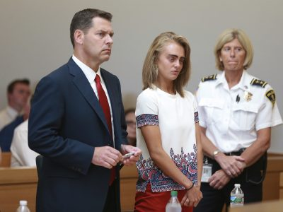 With her defense attorney Joseph Cataldo at left, Michelle Carter listens to her sentencing for involuntary manslaughter for encouraging 18-year-old Conrad Roy III to kill himself in July 2014. (Matt West/The Boston Herald via AP, Pool)