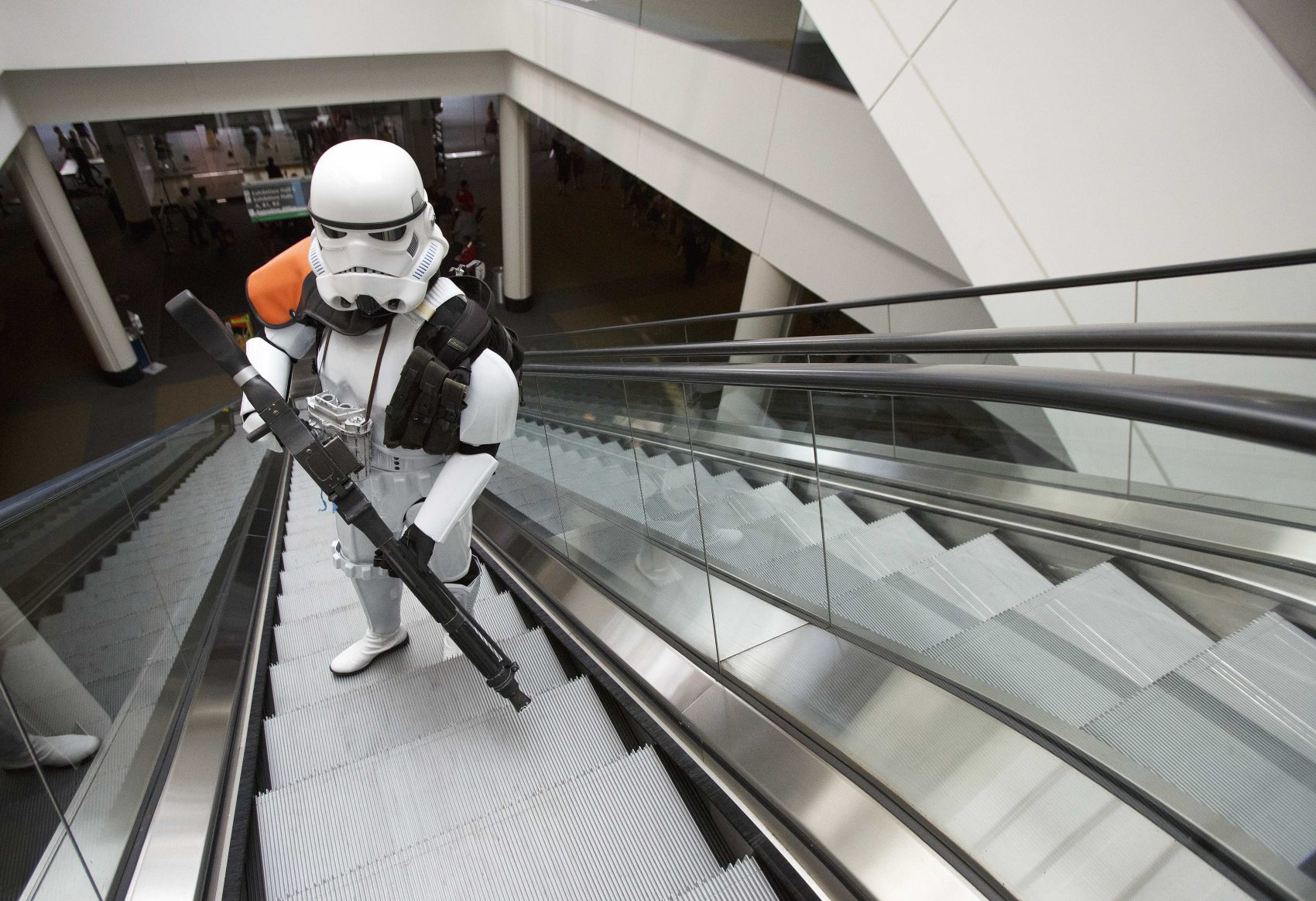 Heindrich Kuhlmann, of Brookline, Mass., rides an escalator dressed as a Star Wars stormtrooper on Friday. The convention was held at the Boston Convention & Exhibition Center through Sunday, August 13th. (AP Photo/Michael Dwyer)