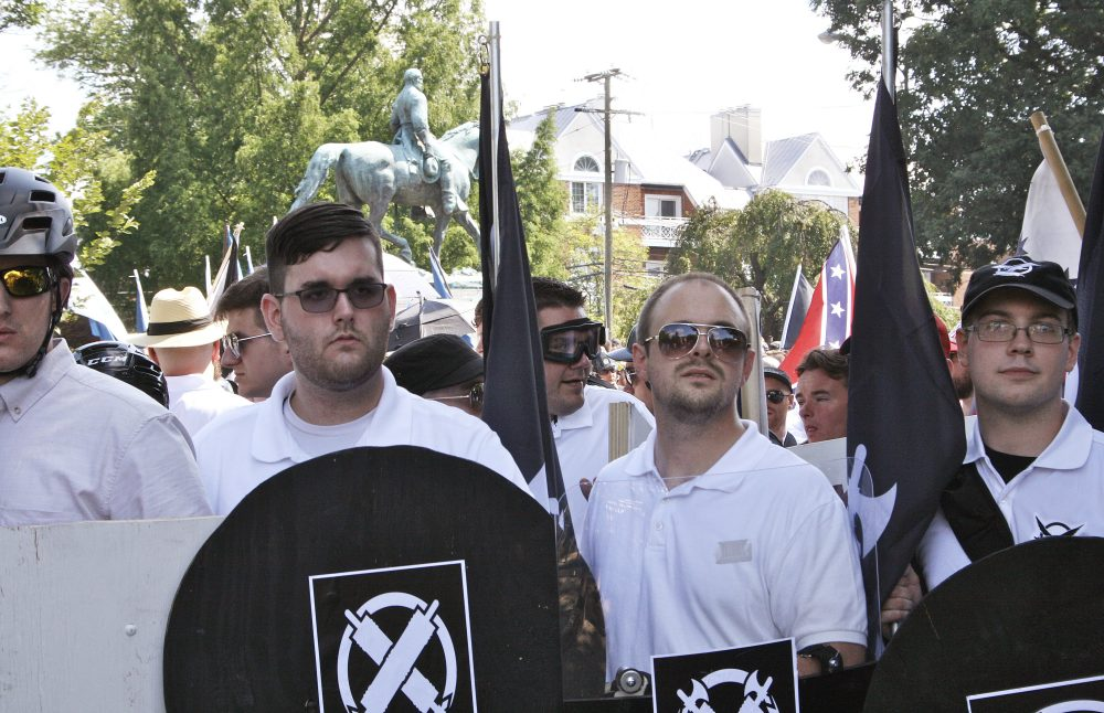 James Alex Fields Jr., second from left, holds a black shield in Charlottesville, Va., where a white supremacist rally took place. Fields, who was the driver in a deadly car attack at the Charlottesville rally, was sentenced to life in prison. (Alan Goffinski/AP)