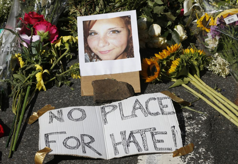 A makeshift memorial of flowers and a photo of victim, Heather Heyer, sits in Charlottesville, Va., Sunday, Aug. 13, 2017. Heyer died when a car rammed into a group of people who were protesting the presence of white supremacists who had gathered in the city for a rally. (Steve Helber/AP)