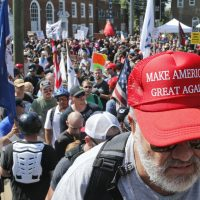 A white nationalist demonstrator walks into Lee Park in Charlottesville, Va., Saturday, Aug. 12, 2017. Hundreds of people chanted, threw punches, hurled water bottles and unleashed chemical sprays on each other Saturday after violence erupted at a white nationalist rally in Virginia. (Steve Helber/AP)