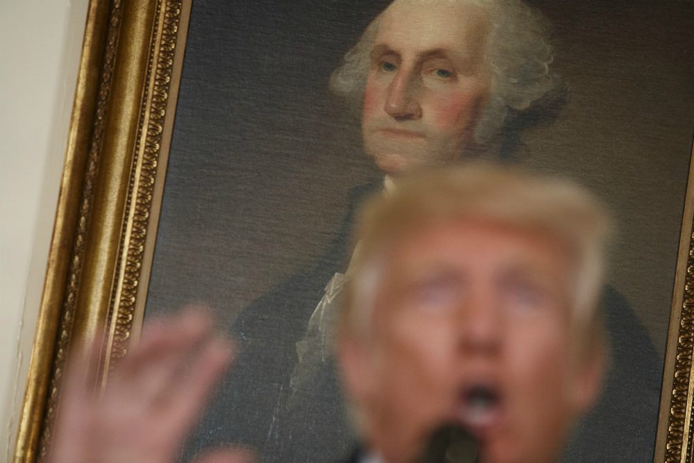 A portrait of George Washington hangs behind President Donald Trump as he speaks about the deadly white nationalist rally in Charlottesville, Va., Monday, Aug. 14, 2017, in the Diplomatic Room of the White House in Washington. (Evan Vucci/ AP)