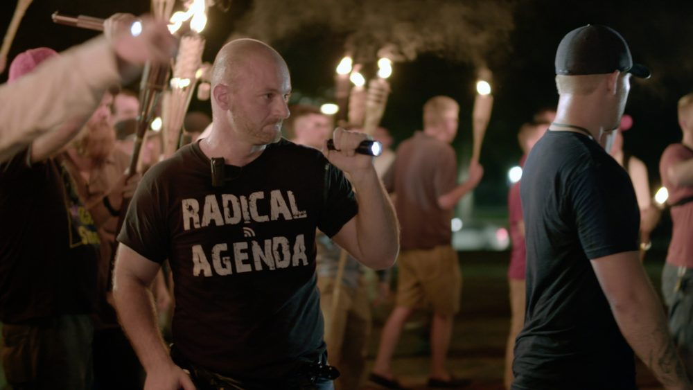 """This Friday, Aug. 11, 2017, image made from a video provided by Vice News Tonight shows a white nationalist rally in Charlottesville, Va. For all the words flowing since last weekend in Charlottesville, the most striking television reporting has been Vice Media's insider account of the white nationalist movement and what it has wrought. Correspondent Elle Reeve's initial story of the weekend violence took up the entirety of HBO's half-hour """"Vice News Tonight"""" broadcast Monday, Aug. 14, and by Thursday had been viewed more than 36 million times on TV and online. (Vice News Tonight via AP)"""