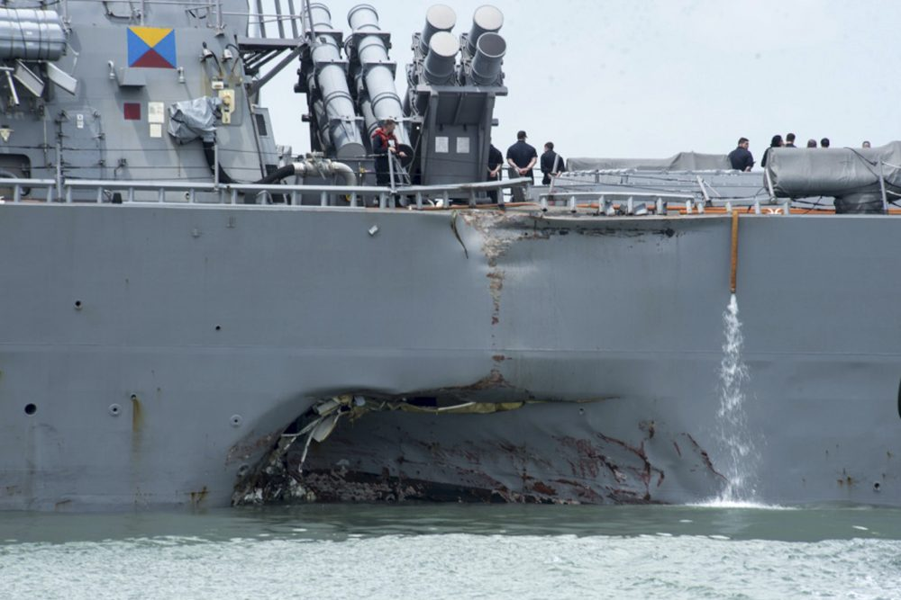 Damage is visible as the guided-missile destroyer USS John S. McCain steers towards Changi naval base in Singapore following a collision with the merchant vessel Alnic MC (Mass Communication Specialist 2nd Class Joshua Fulton/U.S. Navy photo via AP, File)