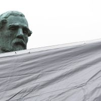 City workers drape a tarp over the statue of Confederate General Robert E. Lee in Emancipation park in Charlottesville, Va., on Aug. 23, 2017. (Steve Helber/AP)