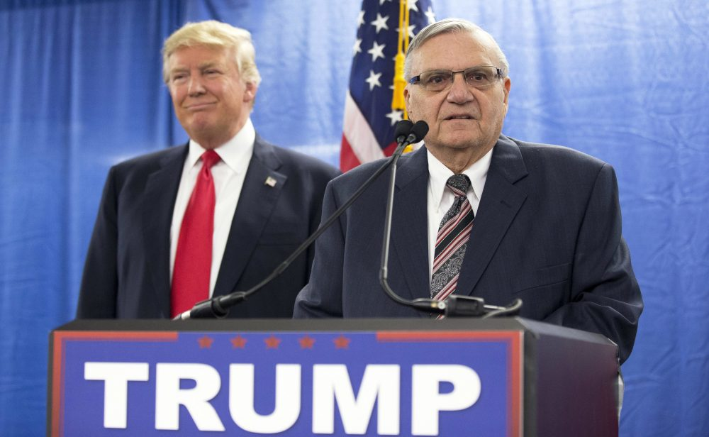 "In this 2016 file photo, then-Republican presidential candidate Donald Trump is joined by then-Maricopa County, Ariz., Sheriff Joe Arpaio during a new conference in Marshalltown, Iowa. Trump has pardoned Arpaio following his conviction for intentionally disobeying a judge's order in an immigration case. The White House announced the move Friday night, saying the 85-year-old ex-sheriff was a ""worthy candidate"" for a pardon. (Mary Altaffer/AP)"