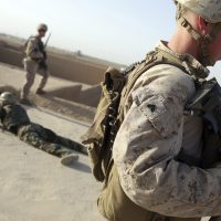 In this picture taken on Sunday, U.S. Marines train Afghan army commandos in the Shorab military camp in Helmand province, Afghanistan. (Massoud Hossaini/AP)