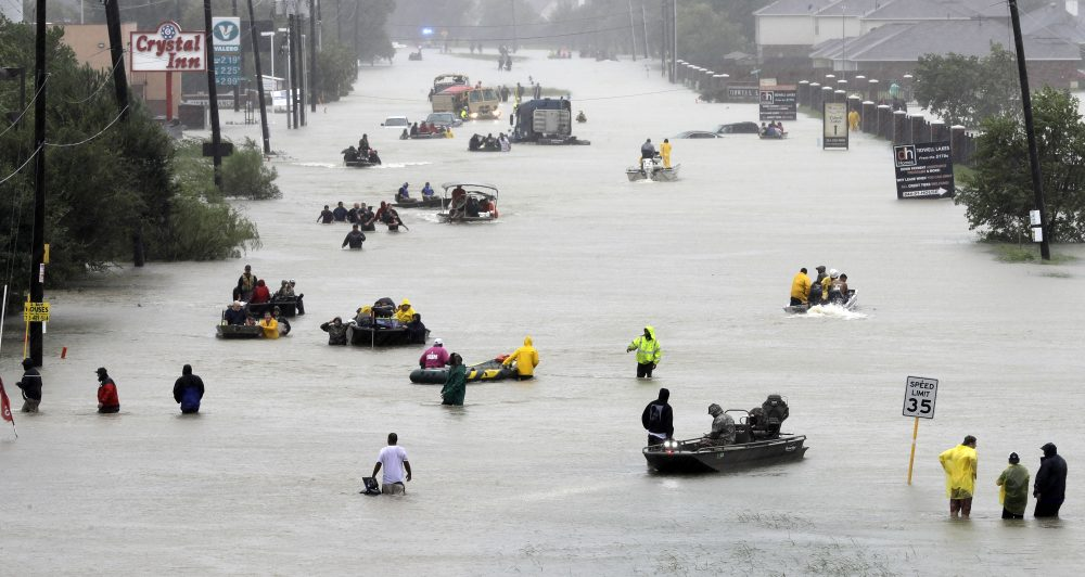 Rescue boats fill a flooded street as flood victims are evacuated as floodwaters from Tropical Storm Harvey rise Monday, Aug. 28, 2017, in Houston. (David J. Phillip/ AP)
