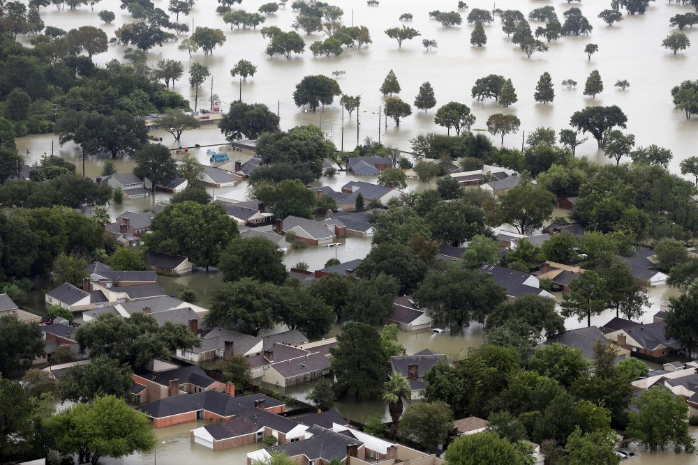 Homes are flooded near the Addicks Reservoir as floodwaters from Tropical Storm Harvey rise Tuesday in Houston. (David J. Phillip/AP)