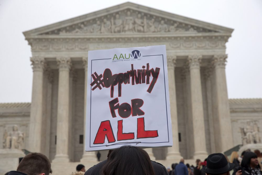 The right, and now Attorney General Jeff Sessions, transforms Asian-Americans into honorary whites, writes Margaret Burnham, for political purposes in the affirmative action debate. Pictured: Pamela Yuen, with the American Association of University Women, holds a sign in favor of affirmative action outside of the Supreme Court in Washington, Wednesday, Dec. 9, 2015, as the court hears oral arguments in the Fisher v. University of Texas at Austin affirmative action case. (Jacquelyn Martin/AP)