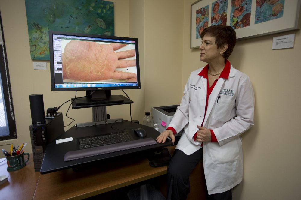 University of Miami dermatologist Dr. Anne Burdick checks the computer screen as she discusses telemedicine on April 8, 2014. (J Pat Carter/AP)