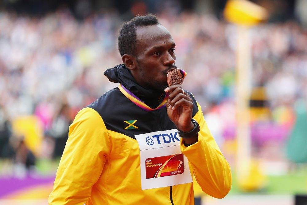 Usain Bolt of Jamaica receives the bronze medal for the men's 100-meter during day three of the IAAF World Athletics Championships in London. (Richard Heathcote/Getty Images)