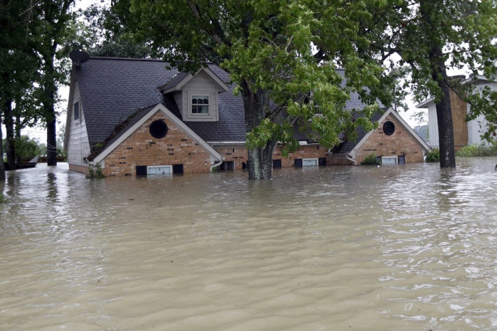 A home is surrounded by floodwaters from Tropical Storm Harvey in Spring, Texas. (David J. Phillip/AP)