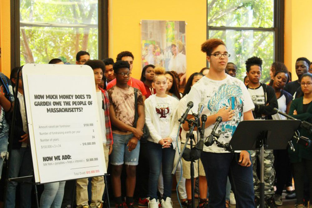 HSTF youth leader Jonah Muñiz speaks at a news conference. (Courtesy of the Hyde Square Task Force)