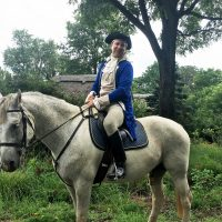 Philip Smucker, wearing colonial garb, rides along a trail in Plains, Virginia. (Shannon Venezia)