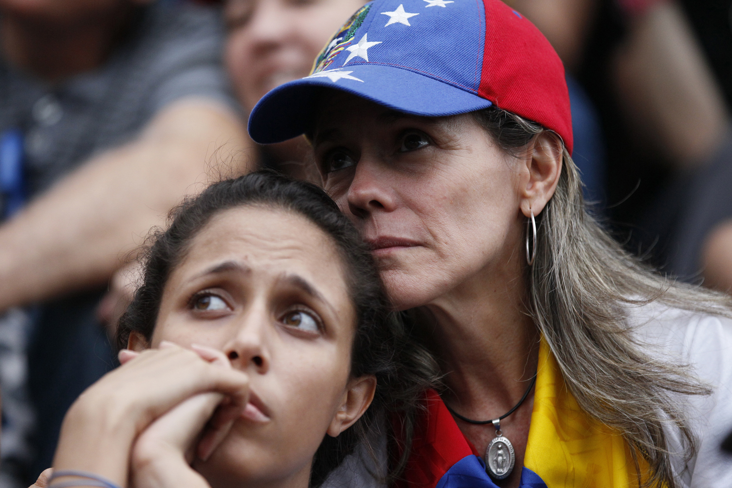 Anti-government demonstrators attend a vigil in honor of those who have been killed during clashes between security forces and demonstrators in Caracas, Venezuela, Monday, July 31, 2017. (Ariana Cubillos/AP)