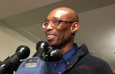 Frederick Clay speaks with reporters after he is freed. (Shannon Dooling/WBUR)