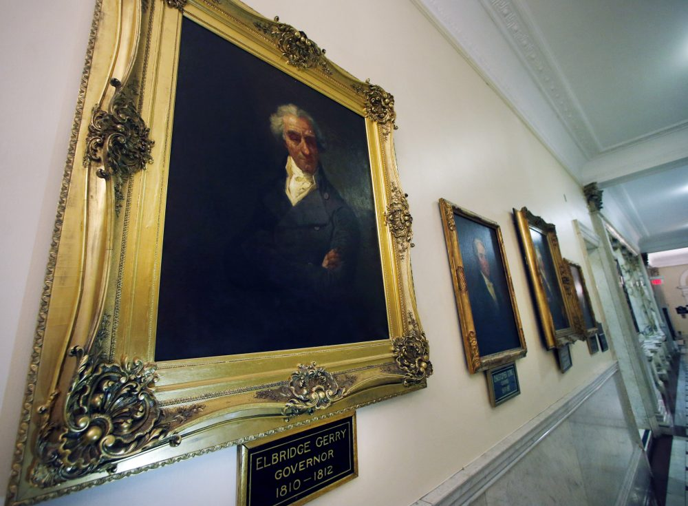 A group of Boston-based mathematicians calling themselves the Metric Geometry and Gerrymandering Group are using their math superpowers to fight back against gerrymandering. Here, a portrait of Massachusetts Gov. Elbridge Gerry hangs in a hallway at the State House in Boston. Gerrymandering is named after Gov. Gerry, who in 1812 signed a bill to redraw the state's district map to benefit his party. (Elise Amendola/AP)