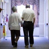 Decima Assise and Harry Lomping walk the halls, Friday, Nov. 6, 2015, at The Easton Home in Easton, Pa. (Matt Rourke/AP)