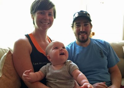 Erin and Jeff with their daughter, Nora, in 2015. (Alex Ashlock/WBUR)