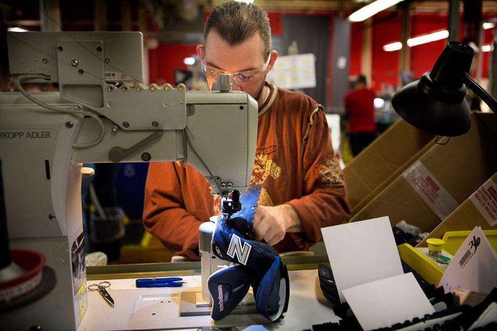 A New Balance factory worker assembling a running shoe. (Jesse Costa/WBUR)