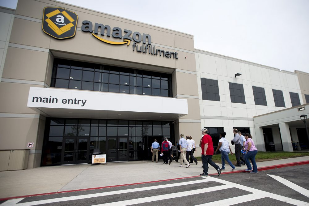 A tour group of Amazon job seekers enters the front door of the Amazon Fulfillment Center in Fall River. (Jesse Costa/WBUR)