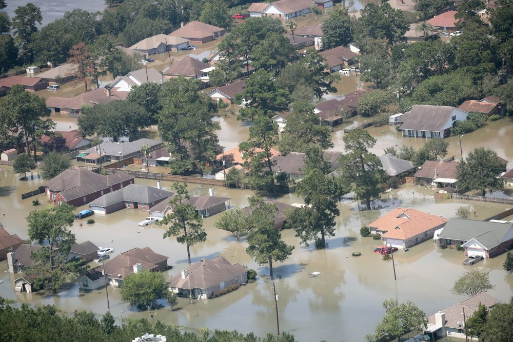 Homes are surrounded by floodwater after torrential rains pounded southeast Texas following Hurricane and Tropical Storm Harvey on Aug. 31, 2017 in Orange, Texas. (Scott Olson/Getty Images)