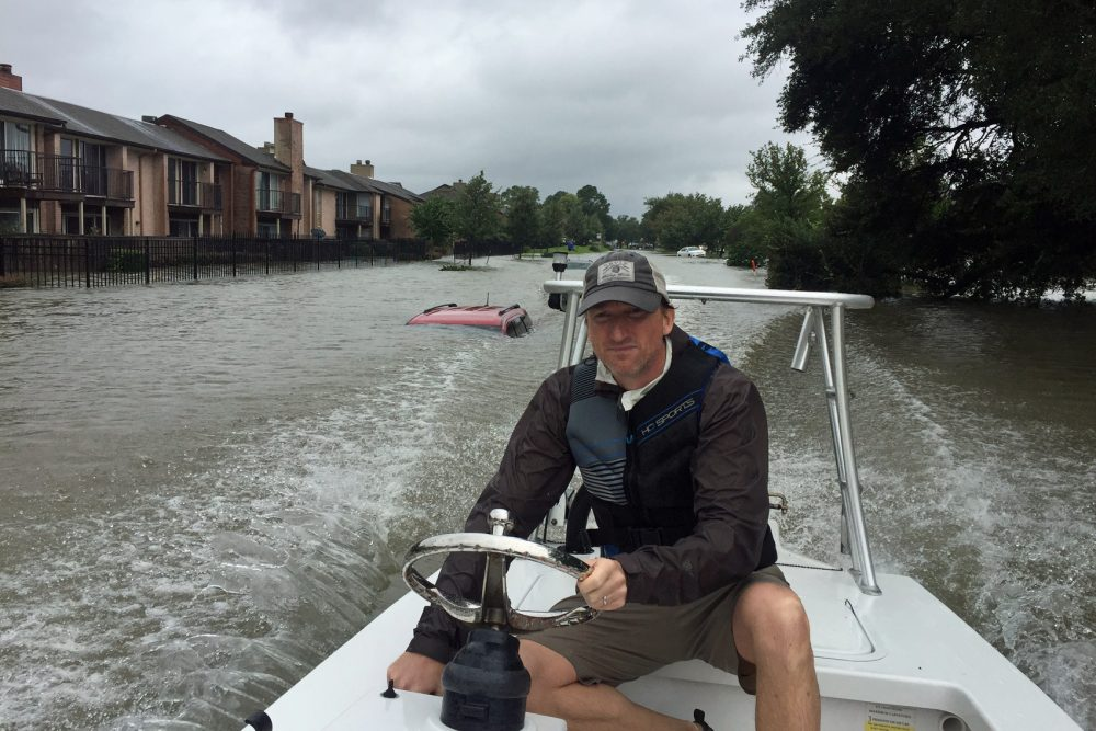Andrew White pilots his boat while making rescues in Houston in the aftermath of Hurricane Harvey on Tuesday. (Courtesy Andrew White)