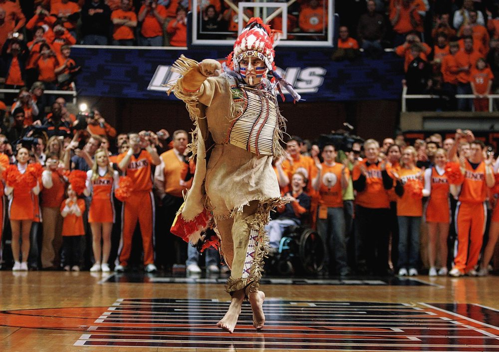 """In this Feb. 21, 2007 file photo, University of Illinois mascot Chief Illiniwek performs for the last time during an Illinois basketball game in Champaign, Ill. Illinois says the school is ending its tradition of playing """"war chant"""" music during sporting events. (Seth Perlman/AP)"""