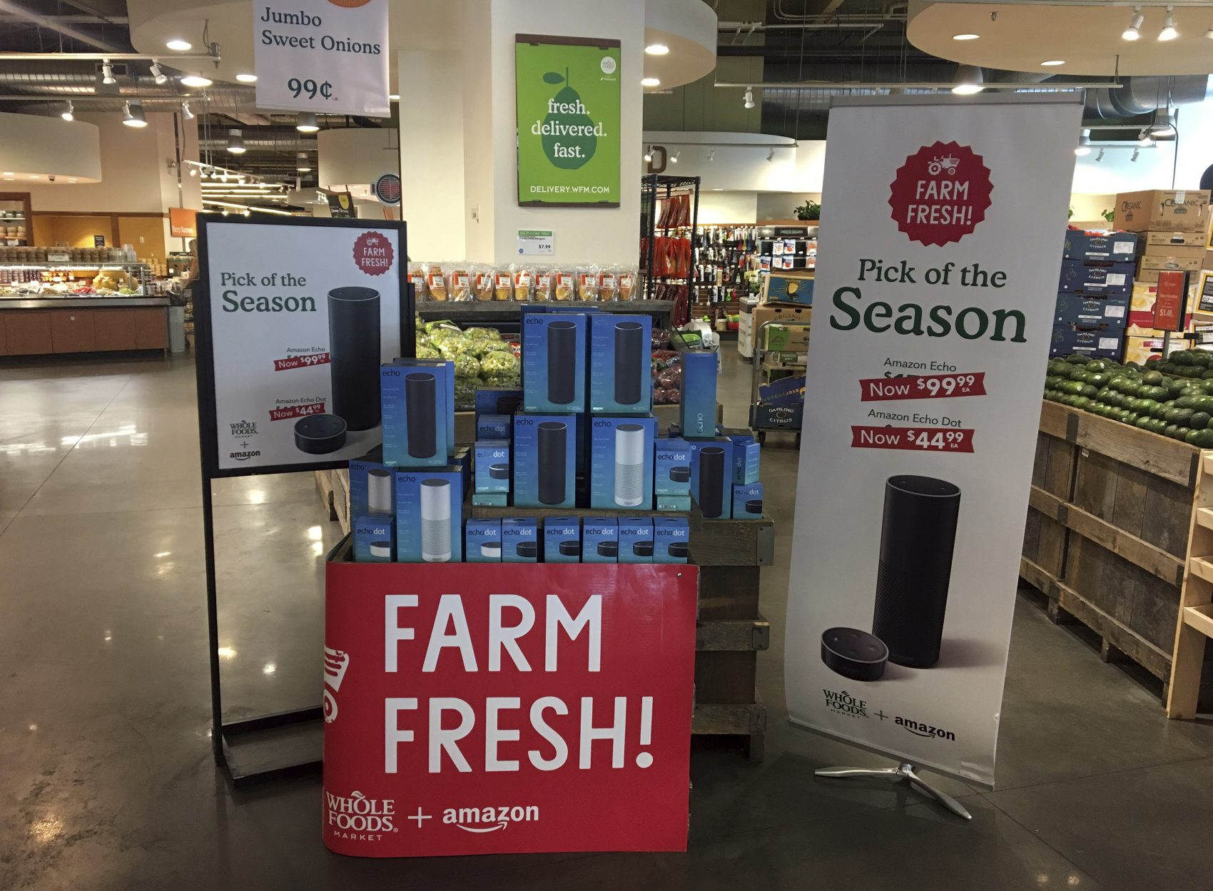 Amazon's Echo and Echo Dot appear on sale at a Whole Foods Market in New York, Monday, Aug. 28, 2017. Amazon has completed its $13.7 billion takeover of organic grocer Whole Foods, and the e-commerce giant is wasting no time putting its stamp on the company. (Joseph Pisani/AP)