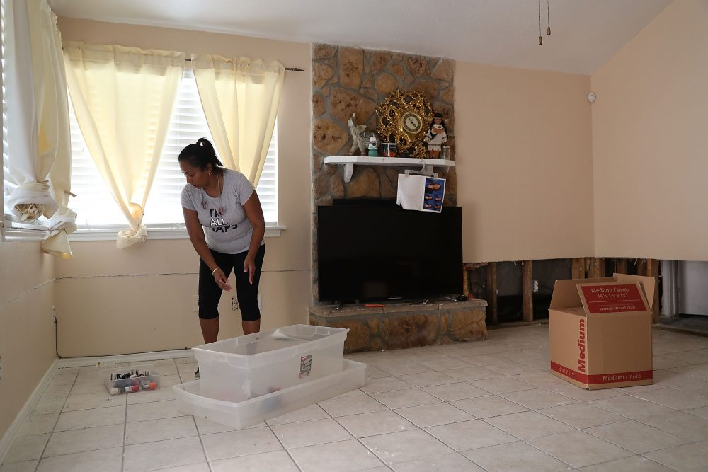 Sally Lacour cleans out her home after it was inundated with water after torrential rains caused widespread flooding during Hurricane and Tropical Storm Harvey on Sept. 2, 2017, in Houston. (Joe Raedle/Getty Images)