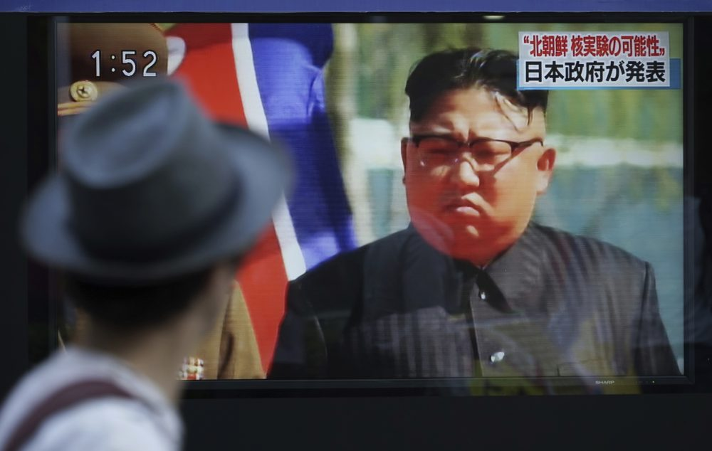 A man watches a TV news program on a public screen showing an image of North Korean leader Kim Jong Un while reporting North Korea's possible nuclear test in Tokyo Sunday, Sept. 3, 2017. (Eugene Hoshiko/AP)