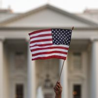 A supporter of the Deferred Action for Childhood Arrivals, or DACA, waves a flag during a rally outside the White House, in Washington, Monday, Sept. 4, 2017. (Carolyn Kaster/AP)