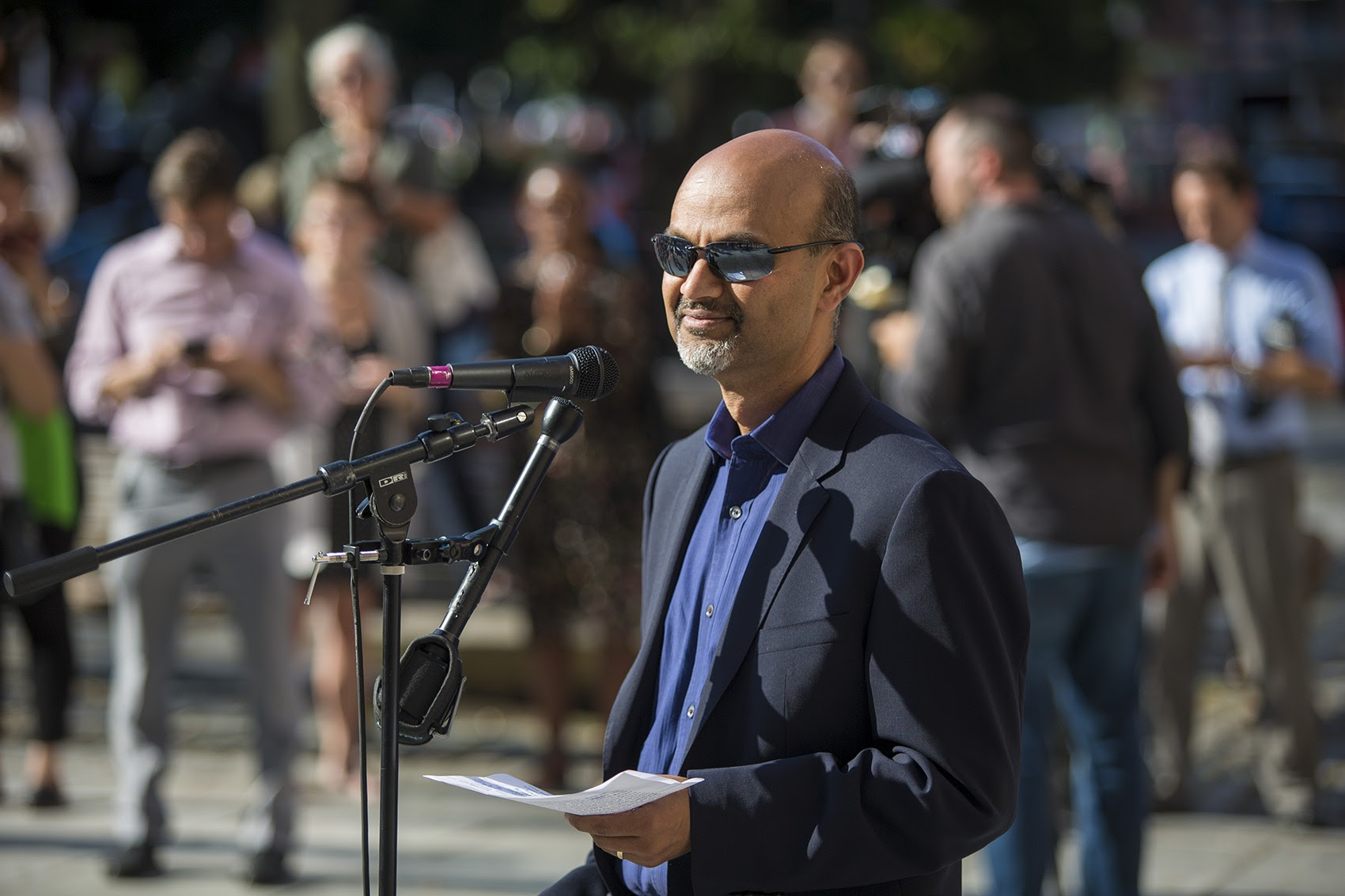 Carbonite CEO Mohamad Ali spoke during a rally in Faneuil Hall Tuesday against the Trump administration's decision to end DACA. (Jesse Costa/WBUR)