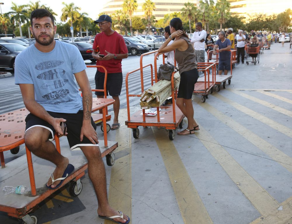 Max Garcia, of Miami, waits in a line since dawn to purchase plywood sheets at The Home Depot store in North Miami, Fla., Wednesday, Sept. 6, 2017. Florida residents are preparing for the possible landfall of Hurricane Irma, the most powerful Atlantic Ocean hurricane in recorded history. (Marta Lavandier/AP)