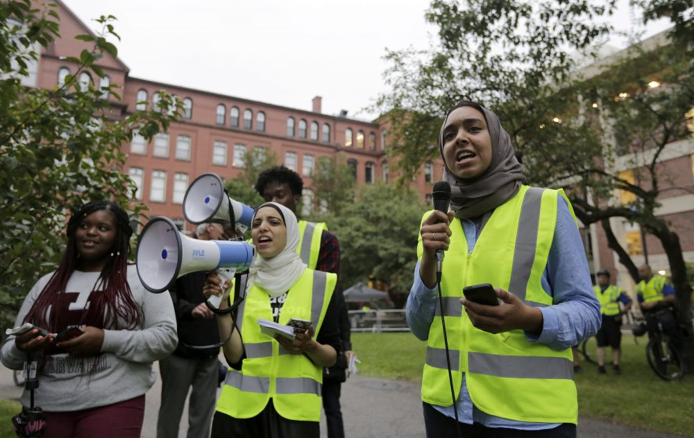 Harvard University students Anwar Omeish, of Fairfax, Va., center, and Salma Abdelrahman, of Miami, right, chant slogans as they protest a scheduled speaking appearance of author Charles Murray at Harvard on Wednesday. (Steven Senne/AP)