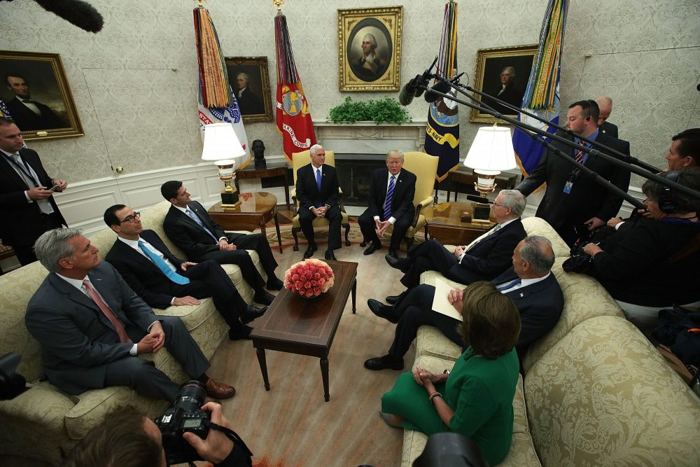 President Trump (top right) and Vice President Mike Pence (top left) meet with: (clockwise from lower left) House Majority Leader Rep. Kevin McCarthy (R-Calif.), Treasury Secretary Steven Mnuchin, Speaker of the House Rep. Paul Ryan (R-Wisc.), Senate Majority Leader Sen. Mitch McConnell (R-Ky.), Senate Minority Leader Sen. Chuck Schumer (D-NY) and House Minority Leader Rep. Nancy Pelosi (D-Calif.) in the Oval Office of the White House September 6, 2017 in Washington, DC. President Trump met with congressional leaders to discuss bipartisan issues. (Alex Wong/Getty Images)