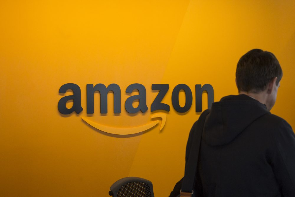 A visitor checks in at the Amazon corporate headquarters on June 16, 2017, in Seattle. (David Ryder/Getty Images)