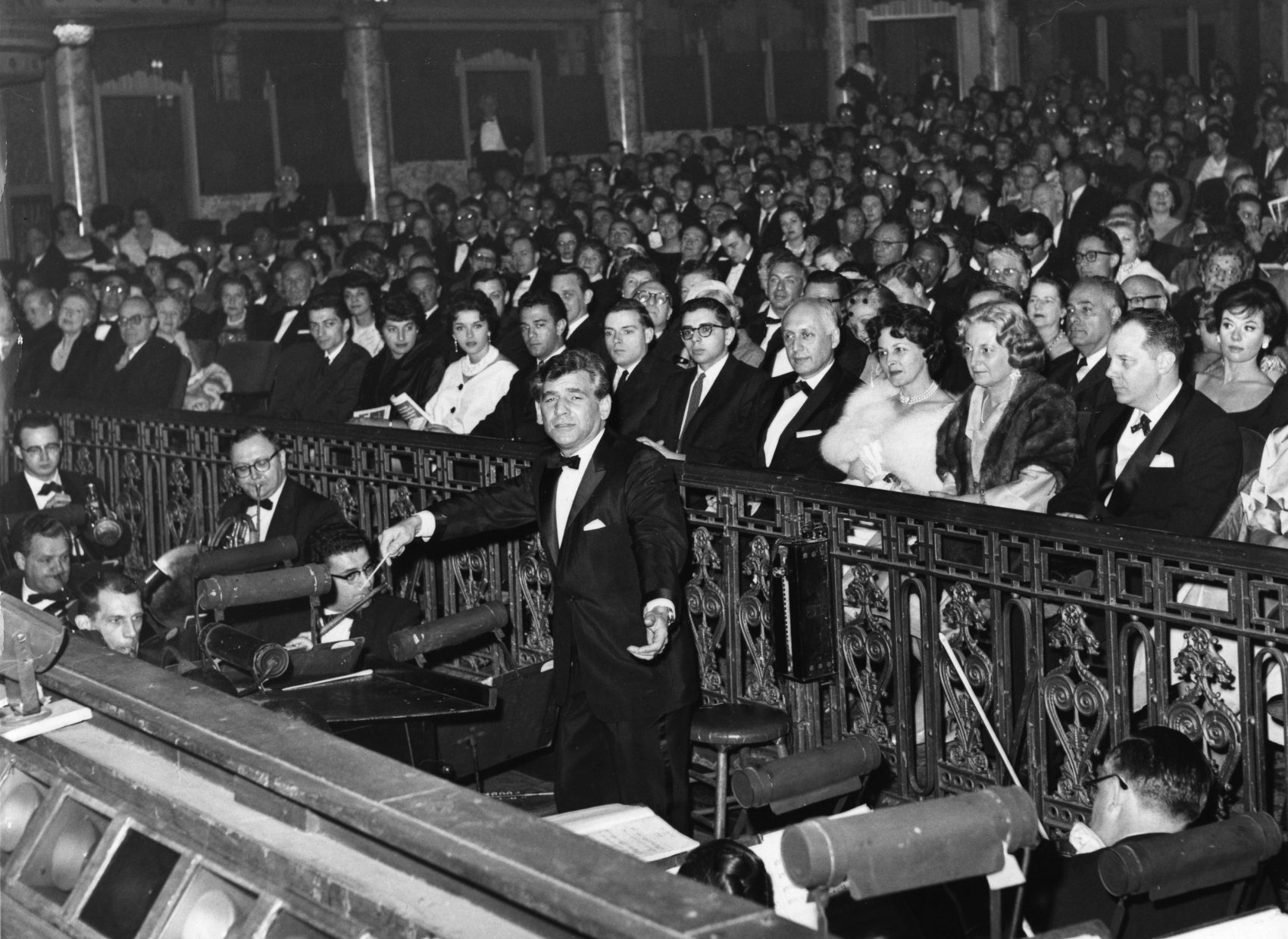 """Leonard Bernstein, who composed the music for the musical """"West Side Story,"""" conducts the orchestra in the overture on April 27, 1960, during the show's reopening in New York. (AP)"""