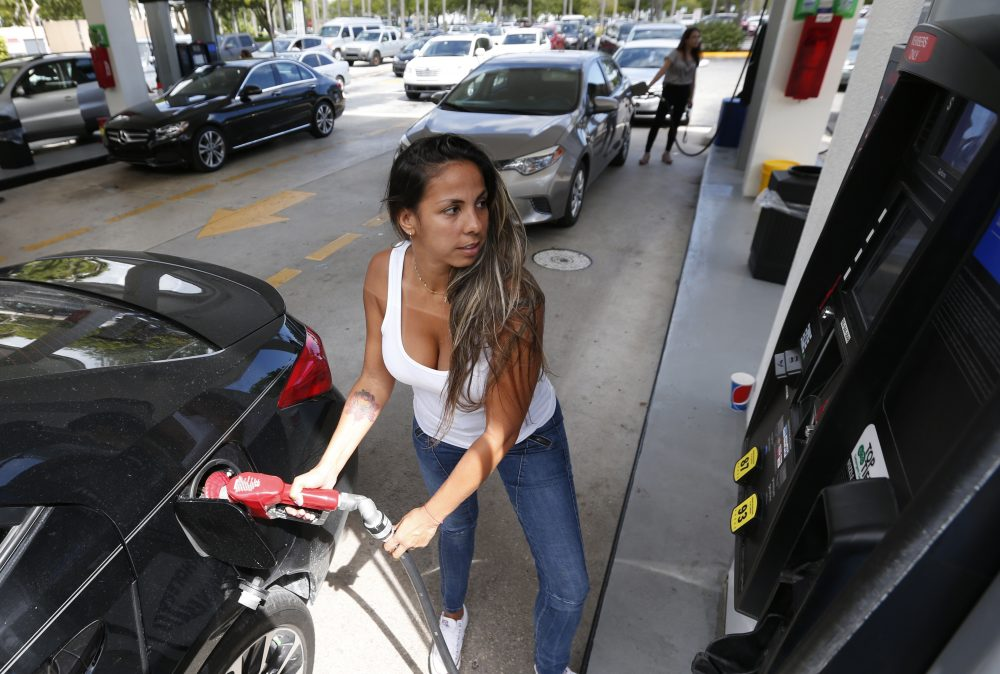 Carli Andrade of Miami, pumps gas at a Costco gas station on Wednesday in North Miami, Fla. ahead of reports that Hurricane Irma is likely to hit the Sunshine State. (Wilfredo Lee/AP)