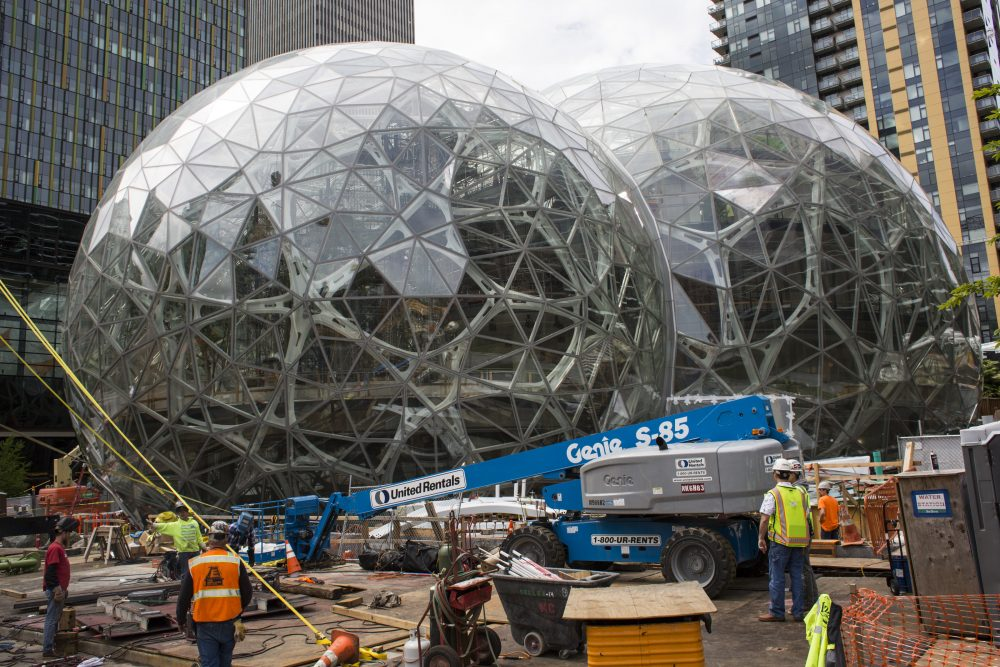 Workers surround the signature glass spheres under construction at the Amazon corporate headquarters on June 16, 2017 in Seattle. (David Ryder/Getty Images)