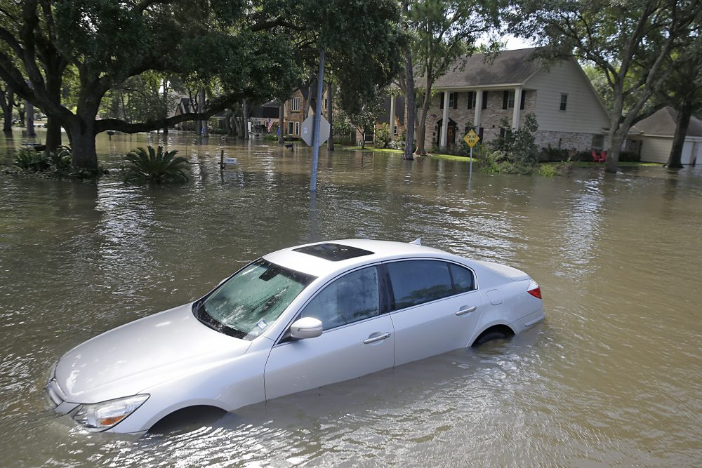 A car floats in a street flooded with water in Lakeside Estate in Houston on Aug. 30, 2017. (Thomas B. Shea/AFP/Getty Images)