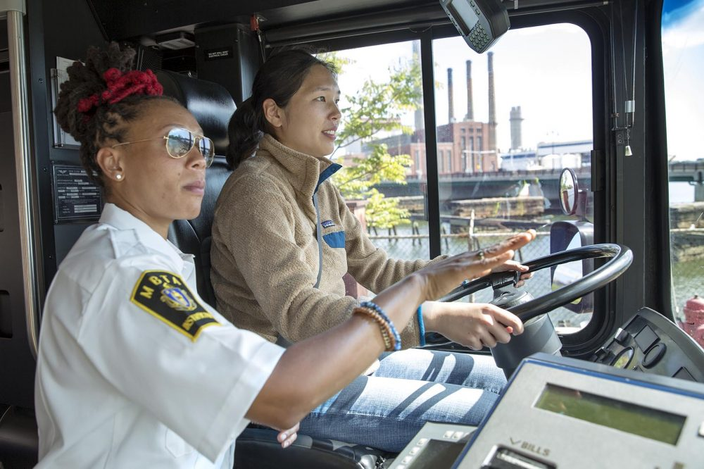 MBTA instructor Shanel Mercer gives Radio Boston's Alison Bruzek a short course on how to drive a bus. (Robin Lubbock/WBUR)