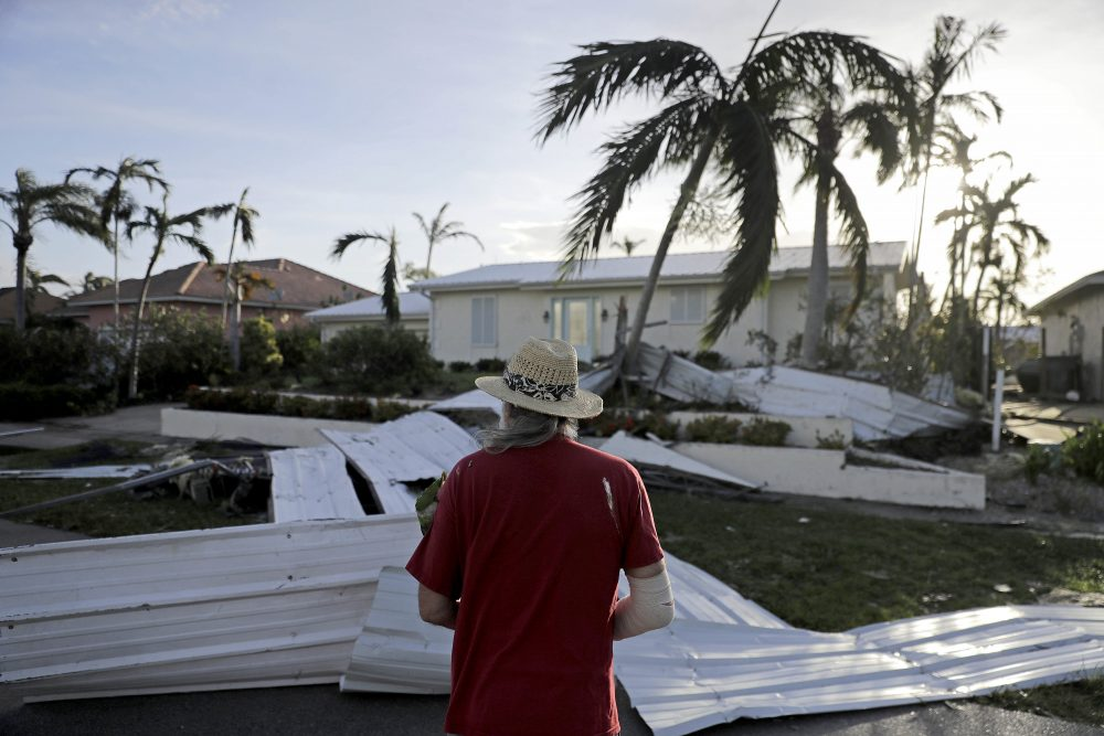 A roof is strewn across a home's lawn as Rick Freedman checks his neighbor's damage from Hurricane Irma in Marco Island, Fla., Monday, Sept. 11, 2017. (David Goldman/AP)